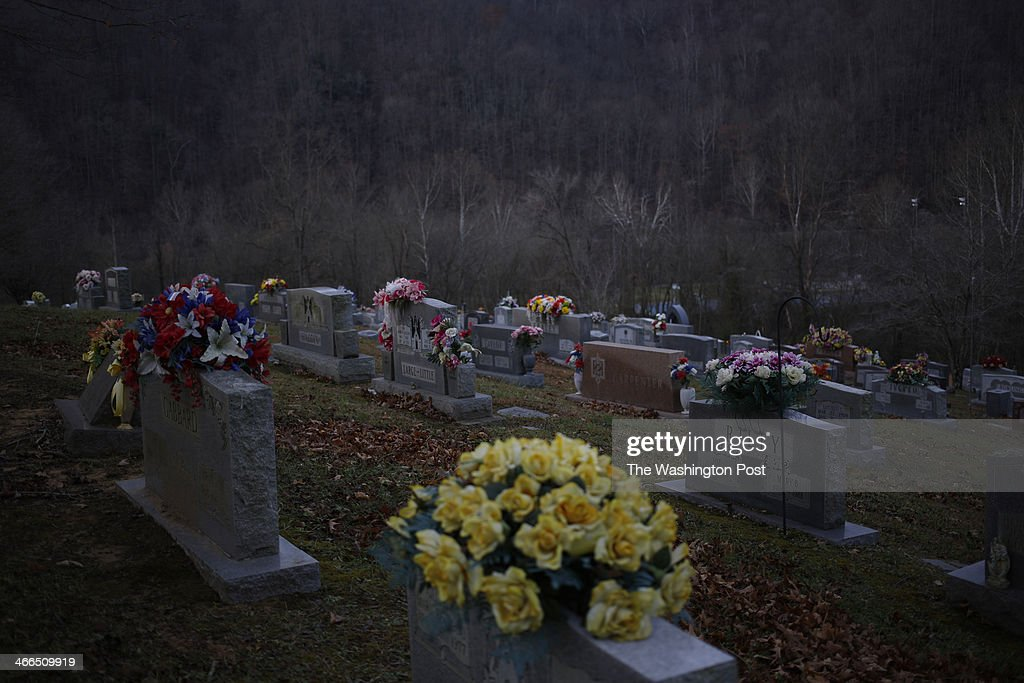 Cemetery graves stand on a hillside in Jackson Cemetery on