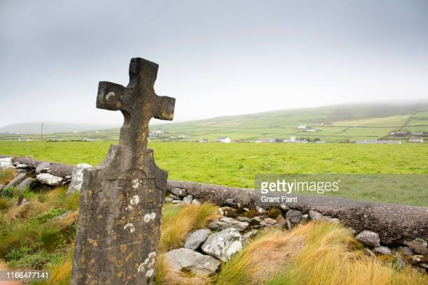 A cemetery in country side with Celtic cross grave marker