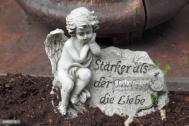 Cemetery in Koblenz Luetzel grave tombstones sculpture angel figure putto cherub epigram love is stronger than the death