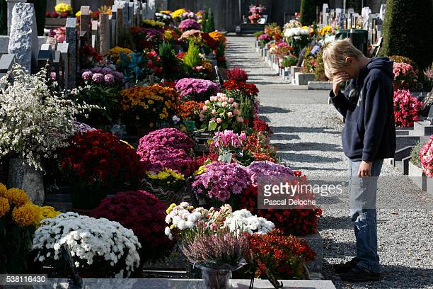 cemetery on all saints' day - sallanches stock pictures, royalty-free photos & images