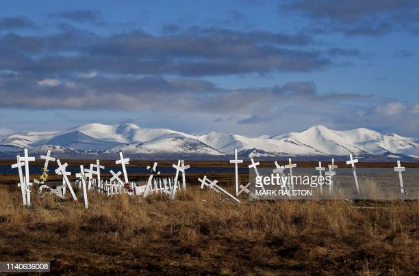 Cemetery sits on melting permafrost tundra at the Yupik Eskimo village of Quinhagak on the Yukon Delta in Alaska on April 12, 2019. - According to...