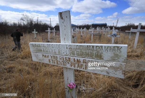 A cemetery that has been relocated and is now a mass grave beacuse of severe erosion of the permafrost tundra at the climate change affected Yupik...