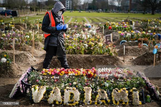 Cemetery volunteer Hashan Rashid prays over the grave of a recently deceased relative at Southern Cemetery during the coronavirus pandemic lockdown...
