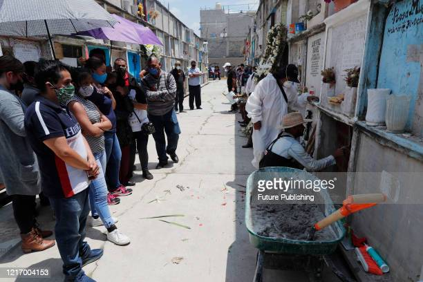 A cemetery worker wears protective gear while prepare a place to a person who died from Coronavirus at Nezahualcoyotl cemetery on June 2 2020 In...
