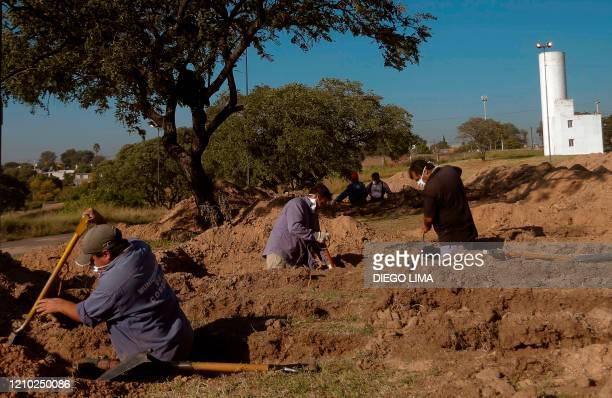 Cemetery workers dig graves during the COVID-19 coronavirus pandemic, at the San Vicente cemetery in Cordoba, Argentina on April 17, 2020.