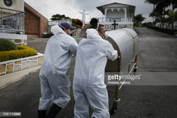 Cemetery workers exhume the body of a person buried four years ago at the Nuestra Senora de Belen cemetery, in Fusagasuga, Colombia, February 11,...