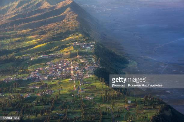 cemoro lawang is the town beside the cliff nearby to mt.bromo in the beautiful morning sunrise - mt semeru stock pictures, royalty-free photos & images