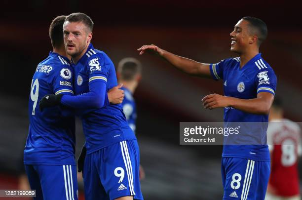 Cengiz Uender Jamie Vardy and Youri Tielemans of Leicester City celebrate following their sides victory in during the Premier League match between...