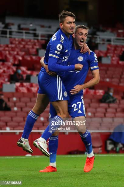 Cengiz Uender of Leicester City and Timothy Castagne of Leicester City celebrate after their teammate Jamie Vardy of Leicester City scored their...