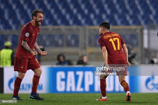 Cengiz Under and Daniele De Rossi of AS Roma celebrate after the UEFA Champions League quarters soccer match between AS Roma and FC Barcelona at the...