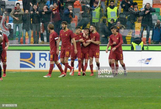 Cengiz Under of AC Rpoma celebrates after scoring his opening goal during the serie A match between Udinese Calcio and AS Roma at Stadio Friuli on...