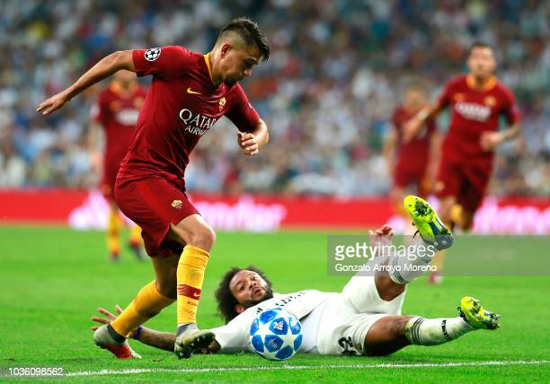 Cengiz Under of AS Roma attempts to get past Marcelo of Real Madrid during the Group G match of the UEFA Champions League between Real Madrid and AS...