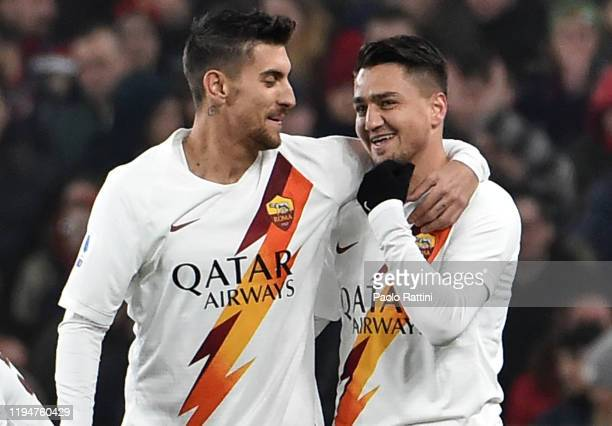 Cengiz Under of AS Roma celebrates with Lorenzo Pellegrini after scoring his first goal during the Serie A match between Genoa CFC and AS Roma at...