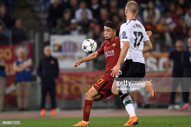 Cengiz Under of AS Roma in action against Ragnar Klavan of Liverpool during the UEFA Champions League semi final return match between AS Roma and...