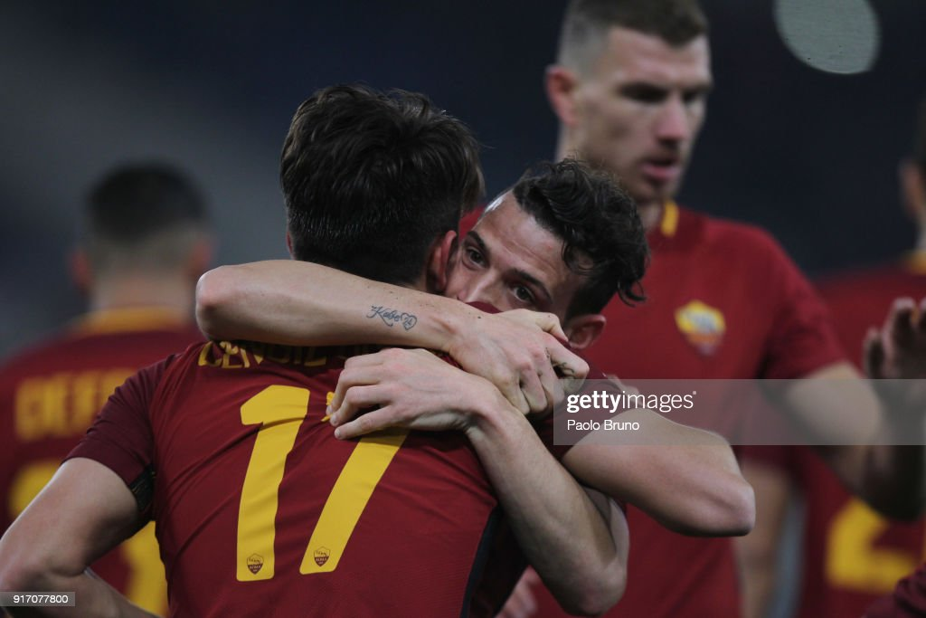 Cengiz Under with his teammate Alessandro Florenzi of AS Roma celebrates after scoring the team's third goal during the serie A match between AS Roma and Benevento Calcio at Stadio Olimpico on February 11, 2018 in Rome, Italy.