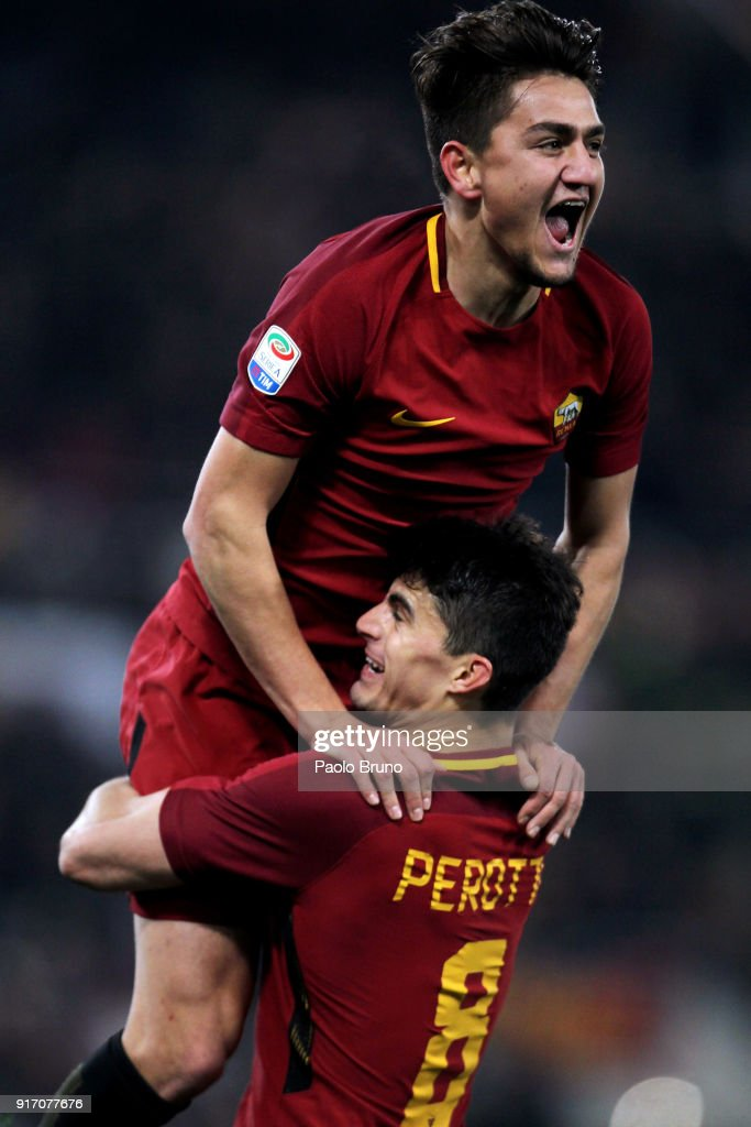 Cengiz Under with his teammate Diego Perotti of AS Roma celebrates after scoring the team's third goal during the serie A match between AS Roma and Benevento Calcio at Stadio Olimpico on February 11, 2018 in Rome, Italy.