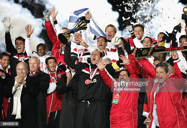 Ceni Rogerio, captain of Sao Paulo captain with FIFA President Sepp Blatter celebrates his side's victory in the FIFA Club World Championship Toyota...