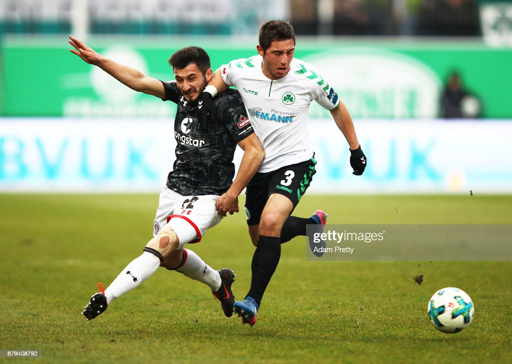 Cenk Sahin of FC St. Pauli is challenged by Maximilian Wittek of SpVgg Greuther Fuerth during the Second Bundesliga match between SpVgg Greuther Fuerth and FC St. Pauli at Sportpark Ronhof Thomas Sommer on November 26, 2017 in Fuerth, Germany.