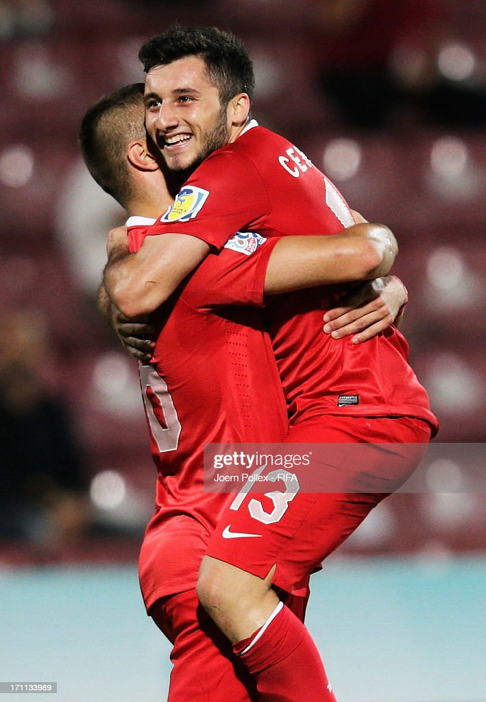 Cenk Sahin (R) of Turkey celebrates with his team mate Ibrahim Yilmaz after scoring his team's third goal during the FIFA U-20 World Cup Group C match between Turkey and El Salvador at Huseyin Avni Aker Stadium on June 22, 2013 in Trabzon, Turkey.