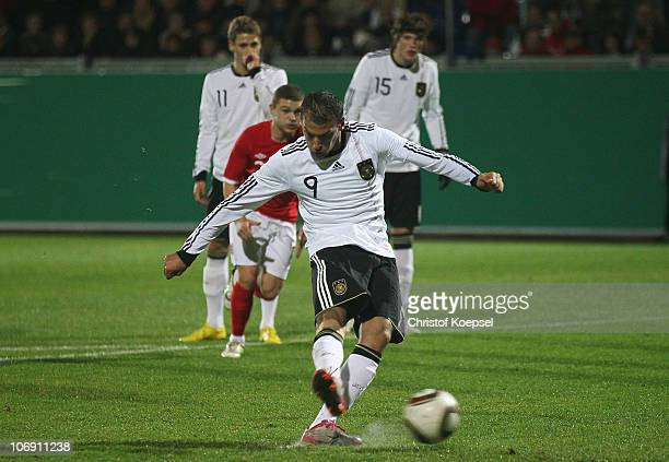Cenk Torsun of Germany scores the second goal by penalty during the U21 international friendly match between Germany and England at the Brita Arena...