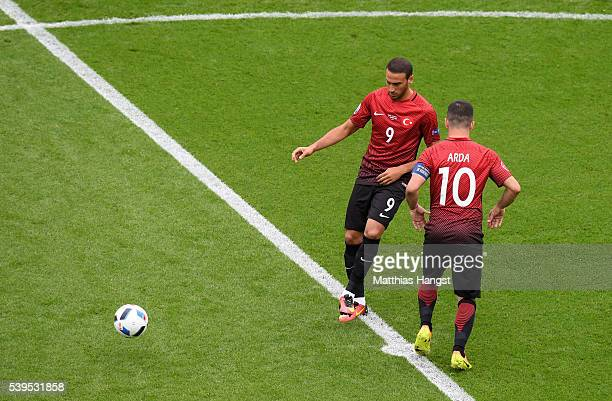 Cenk Tosun and Arda Turan of Turkey kick off during the UEFA EURO 2016 Group D match between Turkey and Croatia at Parc des Princes on June 12 2016...