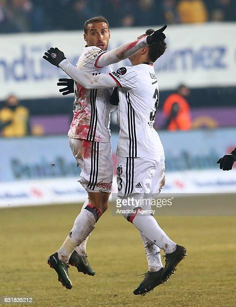 Cenk Tosun of Besiktas celebrates with Adriano Correia after scoring during the Turkish Spor Toto Super Lig football match between Osmanlispor and...