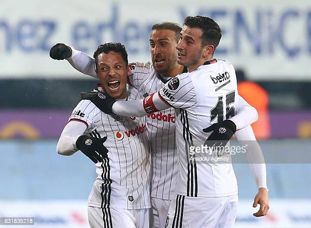 Cenk Tosun of Besiktas celebrates with Adriano Correia and Oguzhan Ozyakup after scoring during the Turkish Spor Toto Super Lig football match...