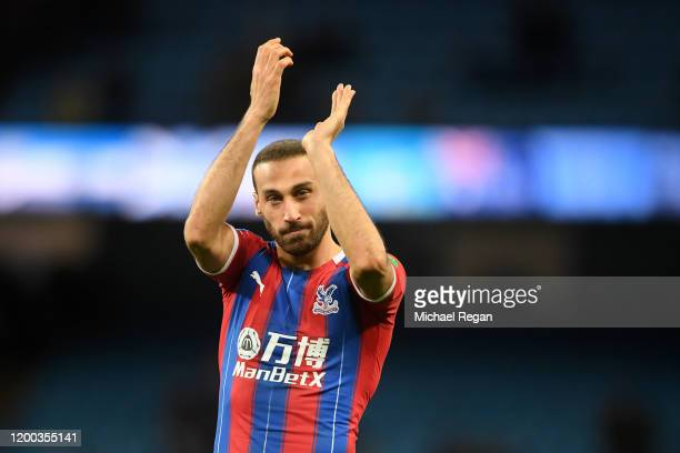 Cenk Tosun of Crystal Palace applauds fans following their draw in the Premier League match between Manchester City and Crystal Palace at Etihad...