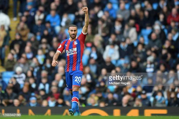 Cenk Tosun of Crystal Palace celebrates after scoring his team's first goal during the Premier League match between Manchester City and Crystal...