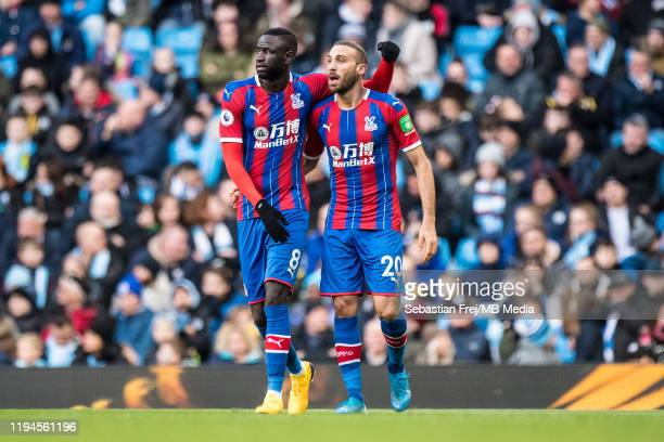 Cenk Tosun of Crystal Palace celebrates with his team mate Cheikhou Kouyaté after scoring a goal during the Premier League match between Manchester...