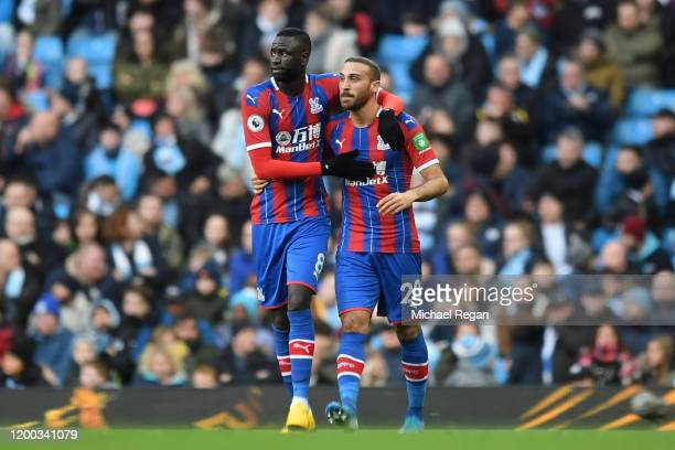 Cenk Tosun of Crystal Palace celebrates with team mate Cheikhou Kouyate of Crystal Palace after scoring their sides first goal during the Premier...