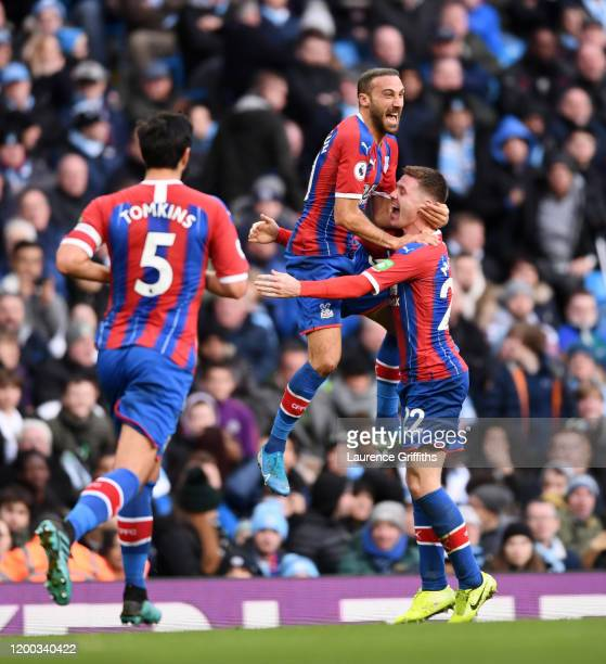 Cenk Tosun of Crystal Palace celebrates with teammates James McCarthy James Tomkins and Gary Cahill of Crystal Palace after scoring his sides first...