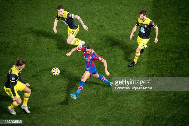 Cenk Tosun of Crystal Palace control ball around Jack Stephens PierrEmile Hojbjerg and Jannik Vestergaard of Southampton FC during the Premier League...