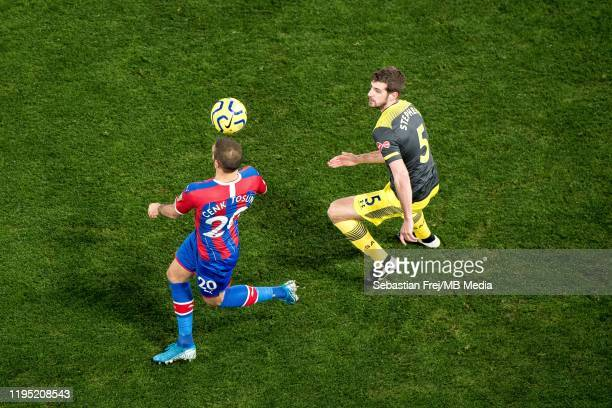 Cenk Tosun of Crystal Palace control ball around Jack Stephens of Southampton FC during the Premier League match between Crystal Palace and...