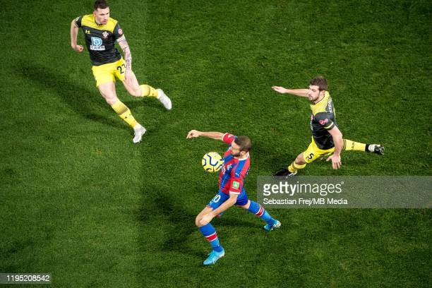 Cenk Tosun of Crystal Palace control ball around Jack Stephens PierrEmile Hojbjerg of Southampton FC during the Premier League match between Crystal...