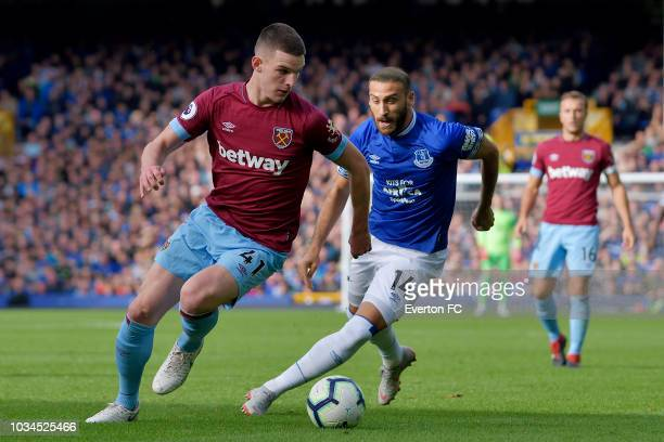 Cenk Tosun of Everton and Declan Rice challenge for the ball during the Premier League match between Everton and West Ham United at Goodison Park on...