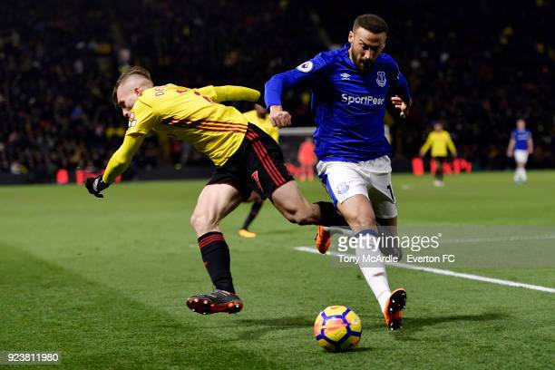 Cenk Tosun of Everton and Gerard Deulofeu challenge for the ball during the Premier League match between Watford and Everton at Vicarage Road on...