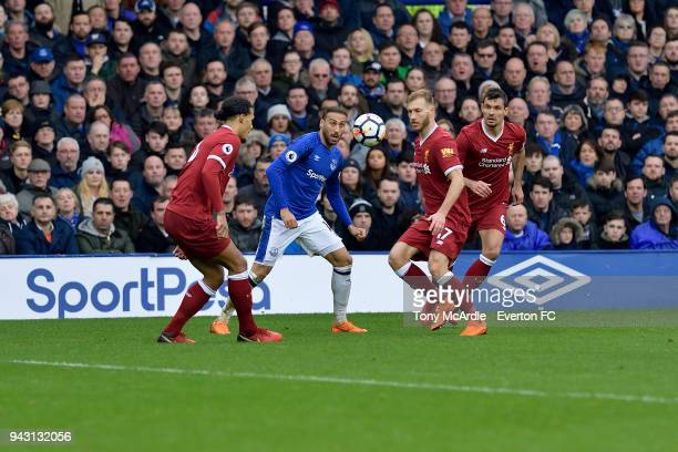 Cenk Tosun of Everton and Ragnar Klavan watch the ball during the Premier League match between Everton and Liverpool at Goodison Park on April 7 2018...