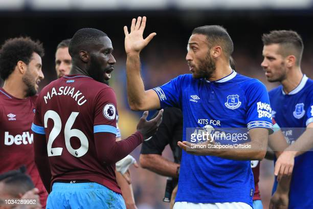 Cenk Tosun of Everton argues with Arthur Masuaku of West Ham during the Premier League match between Everton and West Ham United at Goodison Park on...