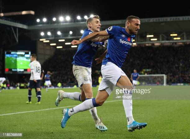 Cenk Tosun of Everton celebrates after scoring his sides first goal during the Premier League match between Everton FC and Tottenham Hotspur at...