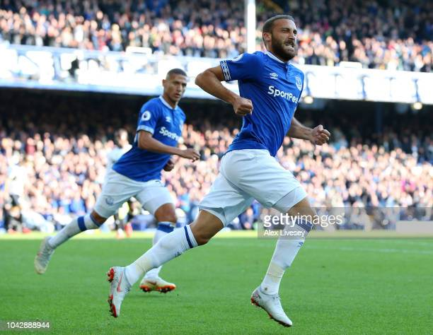 Cenk Tosun of Everton celebrates scoring his sides second goal during the Premier League match between Everton FC and Fulham FC at Goodison Park on...