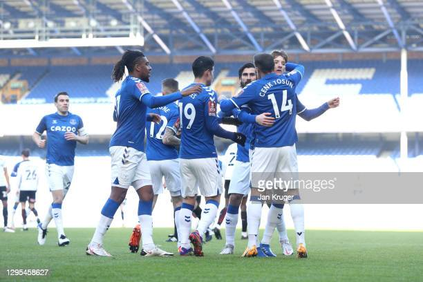 Cenk Tosun of Everton celebrates with Alex Iwobi , Anthony Gordon and teammates after scoring their team's first goal during the FA Cup Third Round...