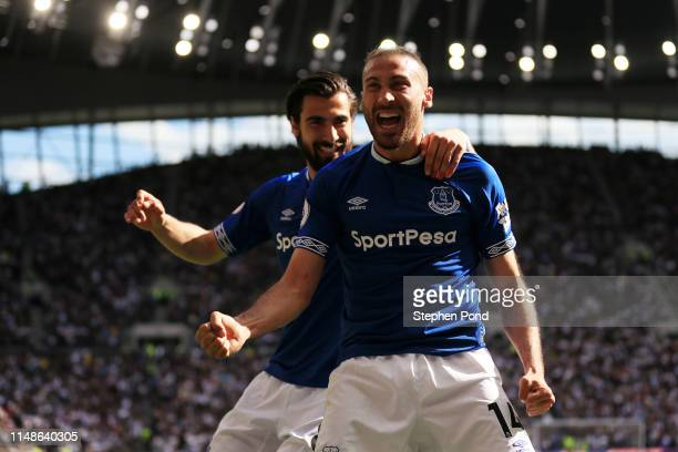Cenk Tosun of Everton celebrates with teammate Andre Gomes after scoring his team's second goal during the Premier League match between Tottenham...
