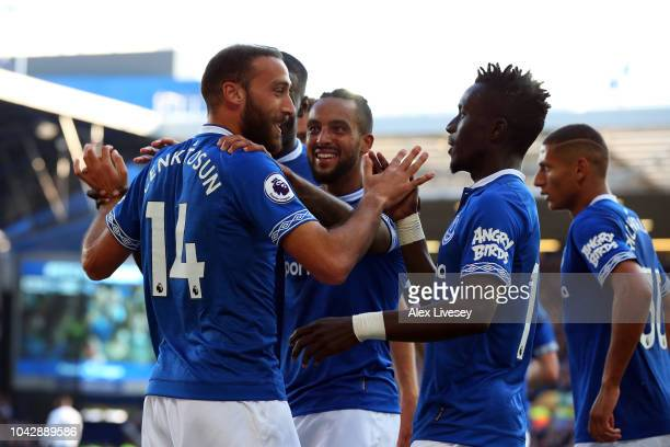 Cenk Tosun of Everton celebrates with teammates after scoring his sides second goal during the Premier League match between Everton FC and Fulham FC...