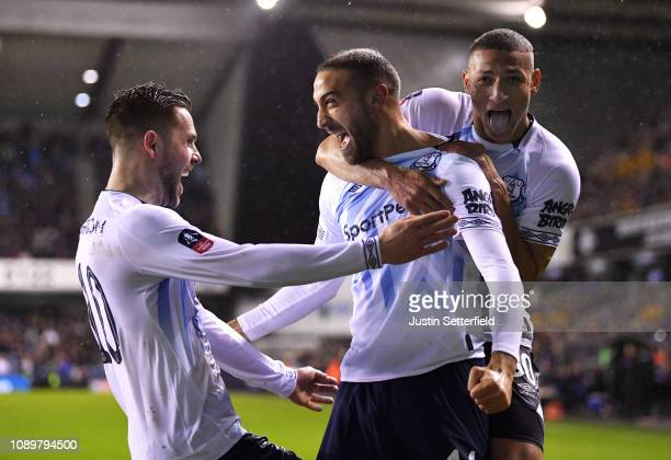 Cenk Tosun of Everton celebrates with teammates after scoring his team's second goal during the FA Cup Fourth Round match between Millwall and...