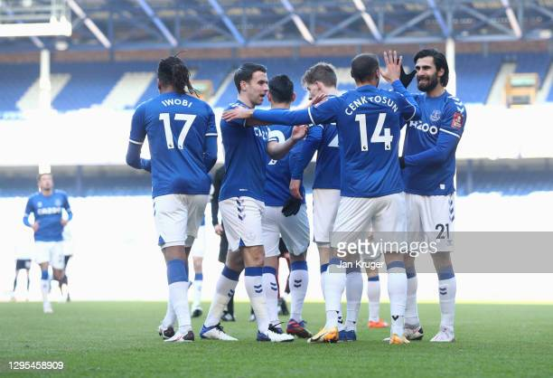 Cenk Tosun of Everton celebrates with teammates Seamus Coleman, and Andre Gomes after scoring his team's first goal during the FA Cup Third Round...