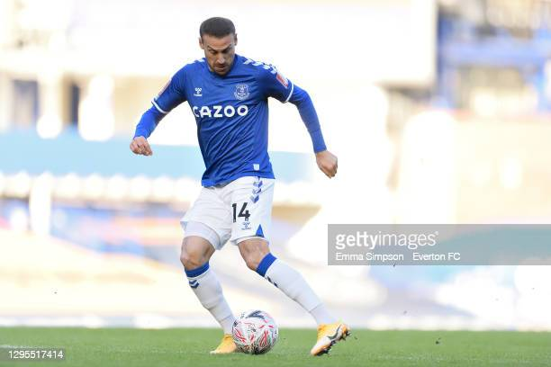 Cenk Tosun of Everton chips the ball to score during the FA Cup Third Round match between Everton and Rotherham United at Goodison Park on January 9...