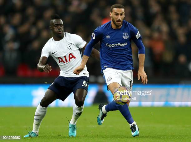 Cenk Tosun of Everton runs with the ball under pressure from Davinson Sanchez of Tottenham Hotspur during the Premier League match between Tottenham...