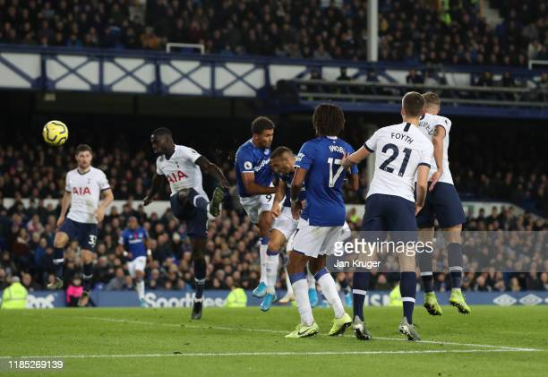 Cenk Tosun of Everton scores his sides first goal during the Premier League match between Everton FC and Tottenham Hotspur at Goodison Park on...