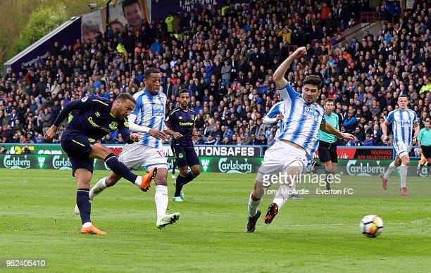 Cenk Tosun of Everton shoots to score his goal during Premier League match between Huddersfield Town and Everton at the John Smith's Stadium on April...